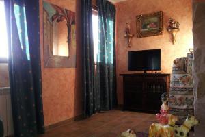 Salón con Televisión del Apartamento Noelia - Las Doncellas