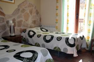 Dormitorio con 2 camas de Casa Laura - Las Doncellas