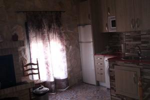 Cocina equipada con fuego de Ruiseñor Arriba